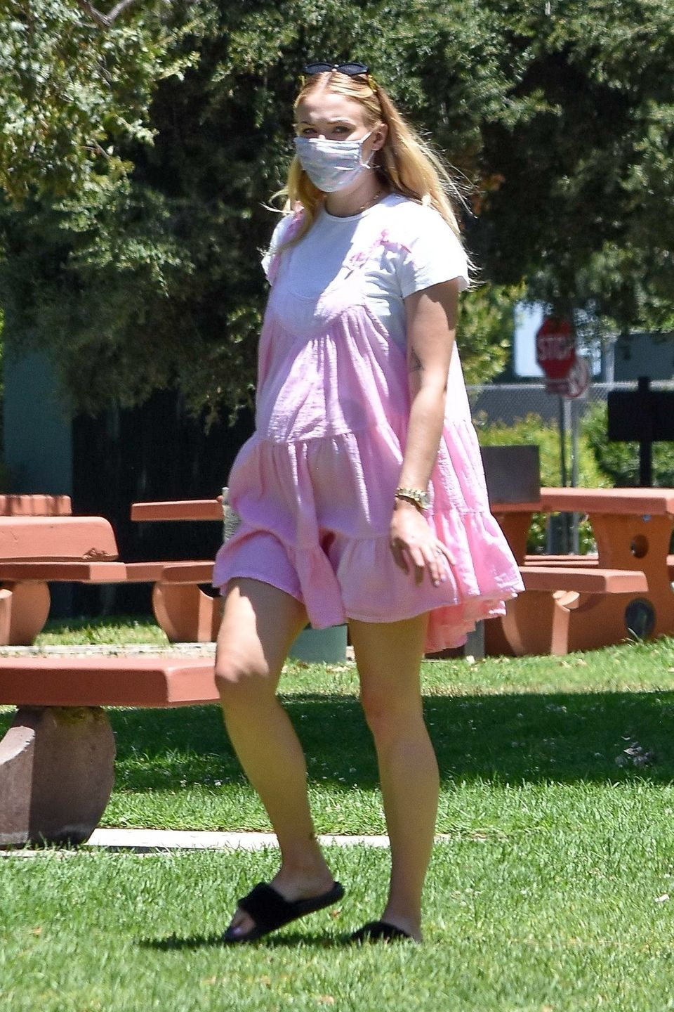 sophie turner wore a pink tiered babydoll dress to a family picnic yahoo lifestyle